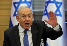 صورة رئيس الوزراء الإسرائيلي بنيامين نتنياهو متهم في قضايا فساد لكنه يتعهد بمواصلة ذلك